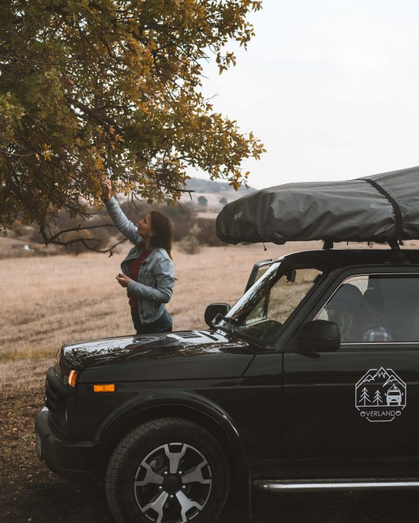Black Lada Niva with Roof top Tent