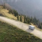 UAZ Buhanka on mountain road drone shot