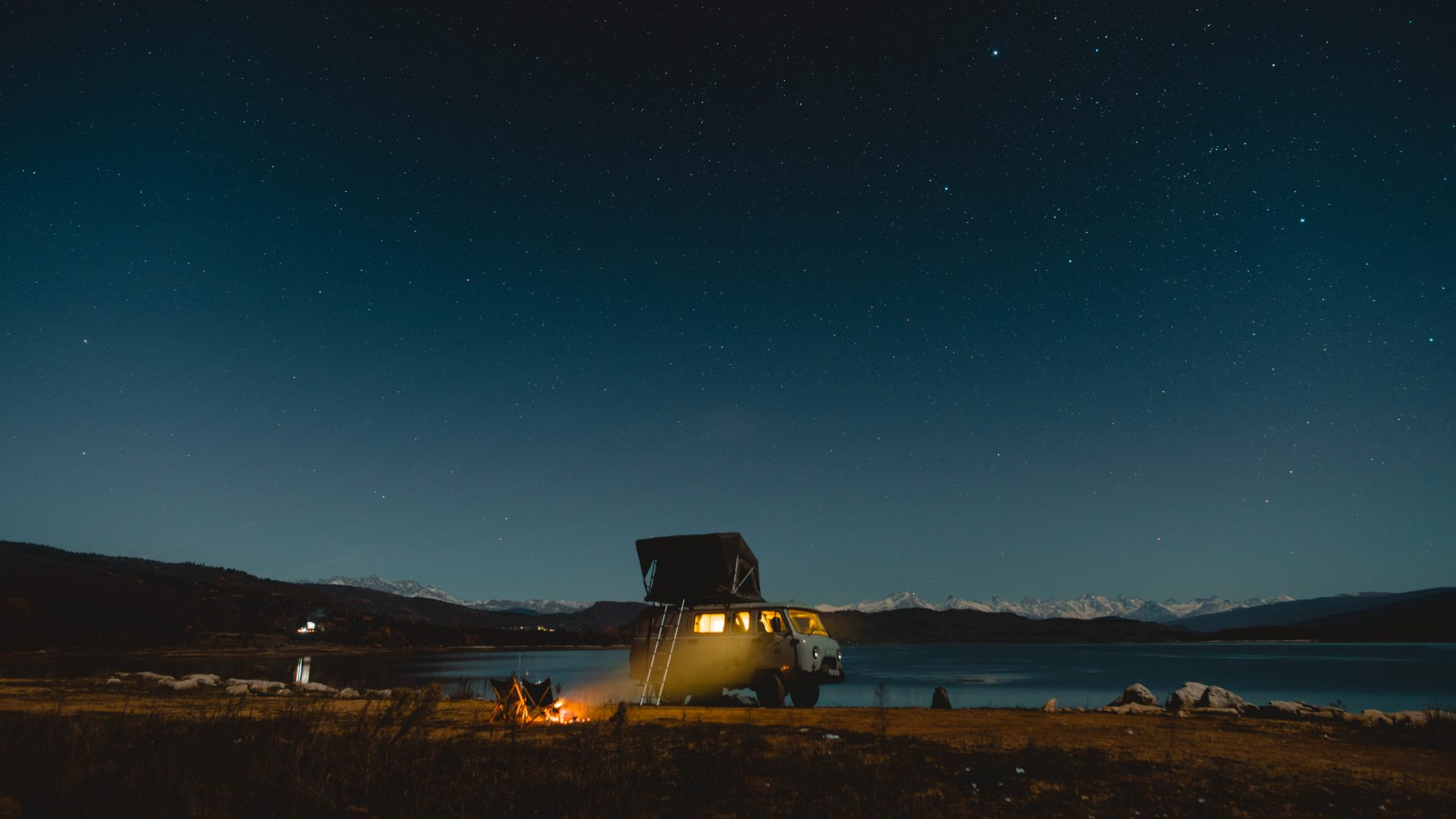 UAZ Buhanka camping at a lake